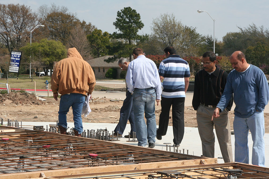 Community members walking at the build site